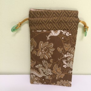 Cell phone holder with draw string, brown & gold embroidery